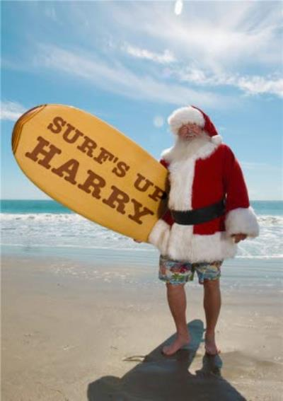 Santa Claus with a surf board on the beach