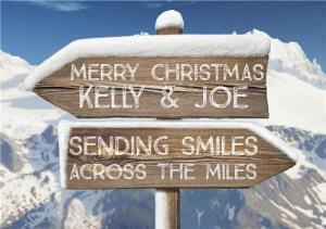 Greeting Cards - Across The Miles Snowy Direction Signs Personalised Christmas Card - Image 1